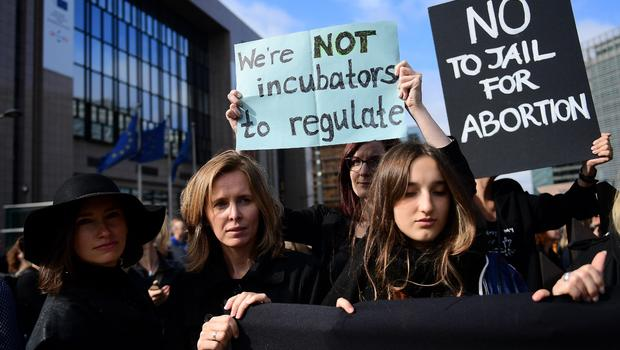 Poland parliament rejects abortion ban after women stage all-out strike.