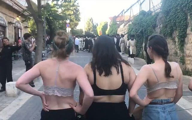 Israeli Ultra-Orthodox Protesters Flee After Counter-Protesters Strip Down To Bras.